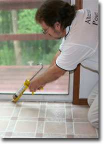 Man sealing a crack with caulk - make money, slow economy, steady income, seasonal work, home weatherization, home inspections, Successful Businesses, make big money online, construction work